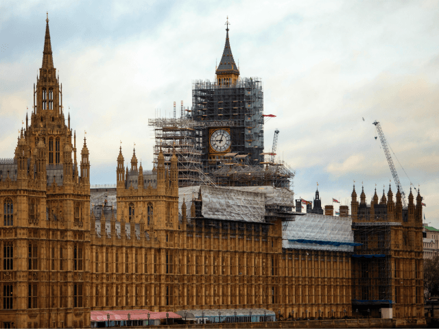 LONDON, ENGLAND - JANUARY 29: The Elizabeth Tower, commonly known as Big Ben stands near the Houses of Parliament on the bank of the River Thames on January 29, 2018 in London, England. Renovation costs of the iconic clock tower building is expected to go over £61 million. (Photo by …