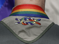 In this June 8, 2014, file photo, a Boy Scout wears his kerchief embroidered with a rainbow knot during Salt Lake City's annual gay pride parade. The Church of Jesus Christ of Latter-day Saints, also known as the Mormon church, said in the statement Tuesday, Jan. 31, 2017, that it's …