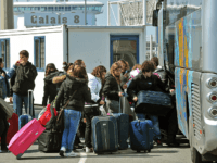 Travellers load their luggage onboard a bus before boarding a ferry to Dover on April 17, 2010, at the Calais harbour, northern France, as Britain has extended a ban on most flights in its airspace until at least 1:00 am (0000 GMT) on Sunday due to the volcanic ash cloud …