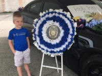 Dakota Pitts, the five-year-old son of a police officer in Terre Haute, Indiana, who was killed in the line of duty, was presented with a police badge in honor of his father.