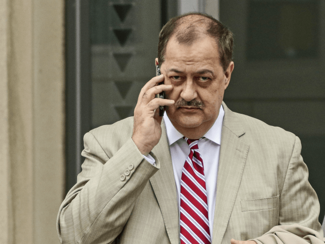 In this Tuesday, Dec. 1, 2015, file photo, former Massey Energy CEO Don Blankenship, left, makes his way out of the Robert C. Byrd U.S. Courthouse during a break in deliberations, in Charleston, W. Va. Blankenship is finishing up his one-year federal prison sentence related to the deadliest U.S. mine …