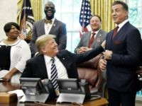 US President Donald Trump acknowledges actor Sylvester Stallone after signing an Executive Grant of Clemency for former heavyweight champion Jack Johnson in the Oval Office of the White House on May 24, 2018 in Washington, DC. (Photo by Olivier Douliery-Pool/Getty Images)