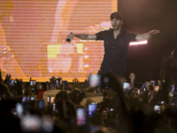 Spanish singer Enrique Iglesias performs on stage in Tel Aviv, Israel, Sunday, May 27, 2018. (AP Photo/Ariel Schalit)
