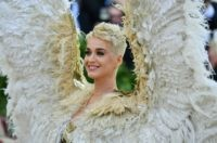 Katy Perry arrives for the 2018 Met Gala on May 7, 2018, at the Metropolitan Museum of Art in New York. - The Gala raises money for the Metropolitan Museum of Arts Costume Institute. The Gala's 2018 theme is Heavenly Bodies: Fashion and the Catholic Imagination. (Photo by Angela WEISS …