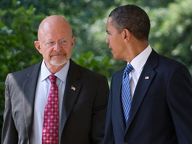 US President Barack Obama walks down the West Wing Colonnade alongside retired General James Clapper, Obama's nominee for director of national intelligence, before making a statement in the Rose Garden of the White House in Washington, DC, June 5, 2010. AFP PHOTO / Saul LOEB (Photo credit should read SAUL …