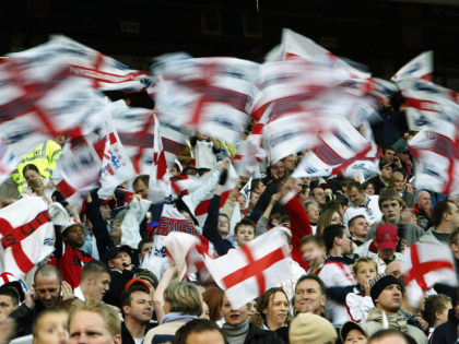 MANCHESTER, ENGLAND - NOVEMBER 16: England fans wave flags during the International Friendly match between England and Denmark at Old Trafford on November 16, 2003 in Manchester, England. (Photo by Laurence Griffiths/Getty Images)