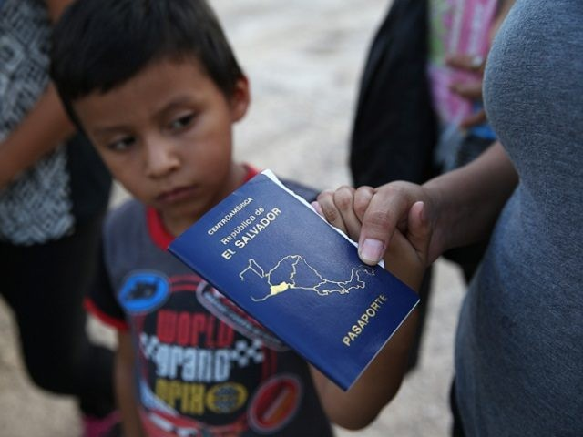 MCALLEN, TX - SEPTEMBER 08: Families of Central American immigrants turn themselves in to U.S. Border Patrol agents after crossing the Rio Grande River from Mexico on September 8, 2014 to McAllen, Texas. Although the numbers of such immigrant families and unaccompanied minors have decreased from a springtime high, thousands …