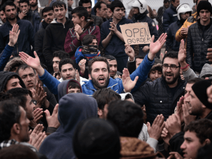 Syrian and Iraqi refugees trapped at the Greek-Macedonian borders protest demanding the opening of the borders on February 28, 2016. More than 5,000 people were trapped at the Idomeni camp after four Balkan countries announced a daily cap on migrant arrivals. Slovenia and Croatia, both EU members, and Serbia and …