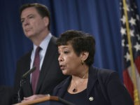 US Attorney General Loretta Lynch (C) speaks during a press conference at the Department of Justice on March 24, 2016 in Washington, DC. At left is FBI Director James Comey. Lynch announced the unsealing of an indictment of seven Iranians on computer hacking charges. / AFP / Mandel Ngan (Photo …