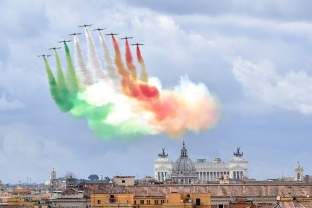 The Italian Air Force aerobatic unit Frecce Tricolori (Tricolor Arrows) spreads smoke with the colors of the Italian flag over the city of Rome on June 2, 2016 as part of the Republic Day ceremony. / AFP / TIZIANA FABI (Photo credit should read TIZIANA FABI/AFP/Getty Images)