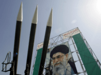 TEHRAN, IRAN: Russian-made Sam-6 surface-to-air missiles are seen in front of a portrait of Iran's Supreme Leader Ayatollah Ali Khamenei at a war exhibition to commemorate the 1980-88 Iran-Iraq war at Baharestan square, south of Tehran 25 September 2005. Saudi Arabia is concerned that US policies are helping Iran make …
