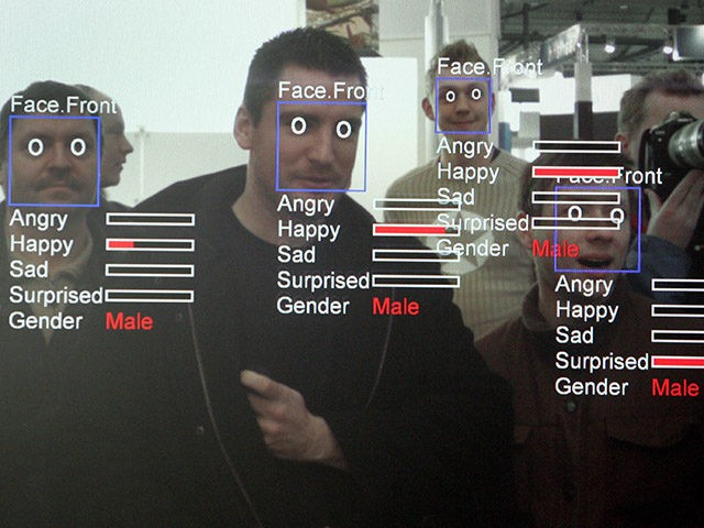 """A photo of a computer screen running """"Real Time Face Detector"""" software shows visitors' expressions analysed and explained in real time at the stand of the Fraunhofer Institute at the CeBIT trade fair in Hanover on March 6, 2008. The Real Time Face Detector is a software module that can …"""