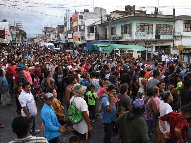 "Central American migrants taking part in a caravan called ""Migrant Viacrucis"" towards the United States march to protest against US President Donald Trump's policies as they remain stranded in Matias Romero, Oaxaca State, Mexico, on April 3, 2018. The hundreds of Central Americans in the ""Way of the Cross"" migrant …"
