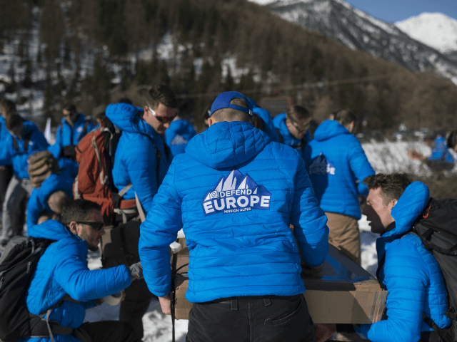 Activists from the French far-right political movement Generation Identitaire (GI) and European anti-migrant group Defend Europe carry supplies during an operation titled 'Mission Alpes' to control access of migrants using the Col de l'Echelle mountain pass on April 21, 2018 in Nevache, near Briancon, on the French-Italian border. - A …