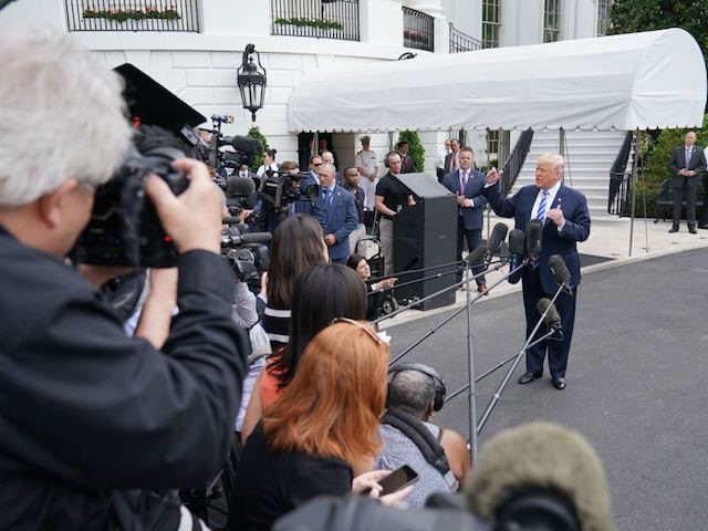 US President Donald Trump speaks to the press before making his way to board Marine One on the South Lawn of the White House on May 4, 2018 in Washington, DC, as he heads to Dallas, Texas to address the National Rifle Association Leadership Forum. (Photo by Mandel NGAN / …