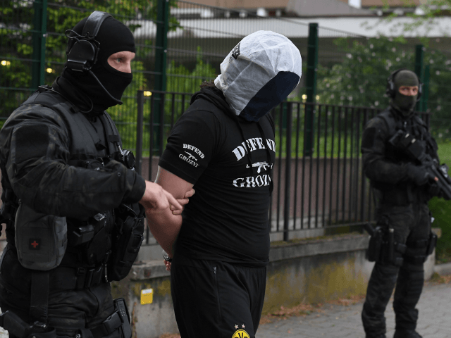 French policemen arrest a man in Strasbourg on May 13, 2018, suspected to be related to a knifeman who killed the day before one man and wounded four other people in Paris. - Investigators on Sunday were probing the background of a 20-year-old Frenchman born in Chechnya who killed one …