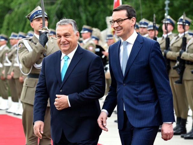 Polish Prime Minister Mateusz Morawiecki and Hungarian Prime Minister Viktor Orban (L) review the honour guard during a welcoming ceremony on May 14, 2018 at the Palace on the Isle in Warsaw's Lazienki Park. (Photo by JANEK SKARZYNSKI / AFP) (Photo credit should read JANEK SKARZYNSKI/AFP/Getty Images)