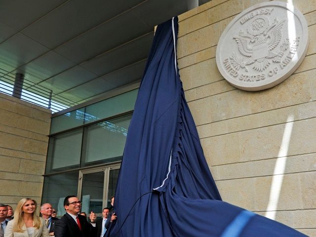 US Treasury Secretary Steve Mnuchin and US President's daughter Ivanka Trump unveil an inauguration plaque during the opening of the US embassy in Jerusalem