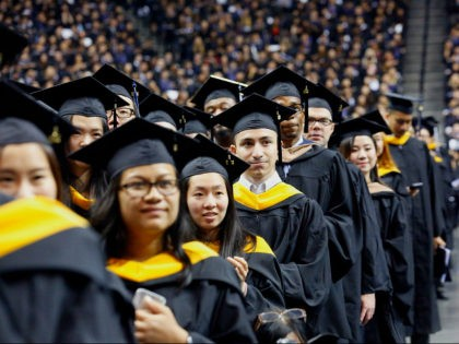 Graduates of Baruch College participate in a commencement program at Barclays Center, Monday, June 5, 2017, in the Brooklyn borough of New York. (AP Photo/Bebeto Matthews)