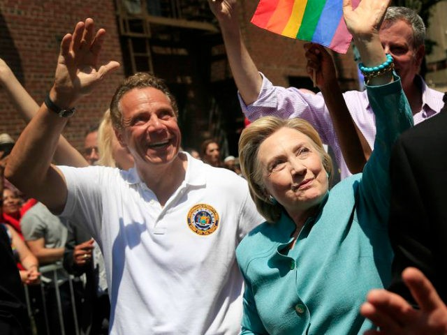 Democratic presidential candidate Hillary Clinton, center, marches with New York Gov. Andrew Cuomo, left, in the New York City Pride Parade in New York, Sunday, June 26, 2016. (AP Photo/Seth Wenig)