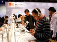 The Huawei booth is shown at the International Consumer Electronics Show in Las Vegas, Thursday, Jan. 10, 2013. (AP Photo/Jae C. Hong)