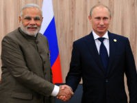 India's Prime Minister Narendra Modi (L) shakes hands with Russia's President Vladimir Putin during their meeting on the sidelines of the BRICS group leaders sumit in Fortaleza, Brazil, on July 16, 2014. Leaders of the BRICS group of emerging powers ( Brazil, Russia, India, China and South Africa) met today …