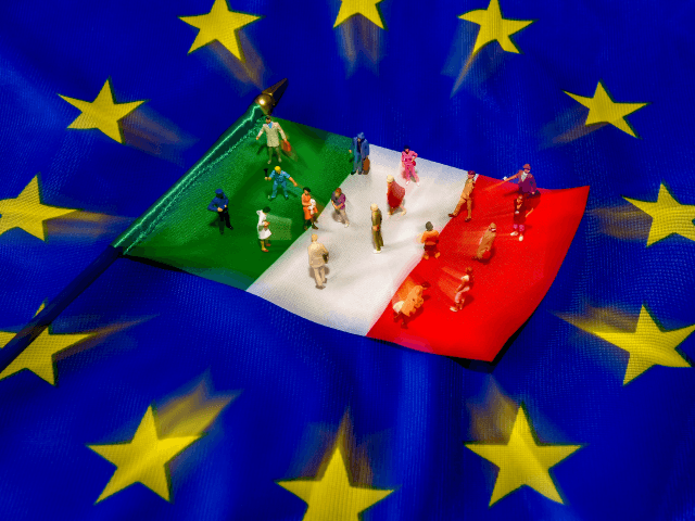 A picture taken on May 30, 2018 shows figurines on an Italian flag lying on a European Union flag. - Italy, one of the European Union's biggest economies, has been plunged into crisis after President Sergio Mattarella at the weekend vetoed the new government's nomination of a fierce eurosceptic as …