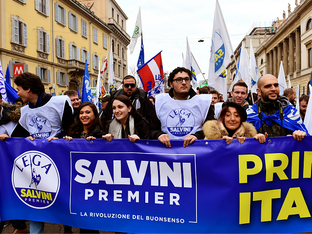 Italian far-right party Lega Nord's (Northern League) supporters hold a banner reading 'Salvini Prime Minister' as they take part in a campaign rally in downtown Milan on February 24, 2018 a week ahead of the Italy's general election. Italy stepped up security for mass demonstrations by far-right and anti-fascist groups …