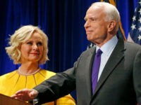 In this Nov. 8, 2016 file photo, Sen. John McCain, R-Ariz., accompanied by his wife Cindy McCain, pauses after speaking in Phoenix. A Trump administration official says that Cindy McCain is likely to take on a prominent State Department role. (AP Photo/Ross D. Franklin, File)