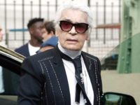 German fashion designer for Chanel, Karl Lagerfeld, arrives to the Chanel women's 2018 Spring/Summer ready-to-wear collection fashion show in Paris, on October 3, 2017. / AFP PHOTO / FRANCOIS GUILLOT (Photo credit should read FRANCOIS GUILLOT/AFP/Getty Images)