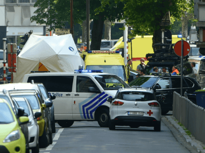 Police and ambulance are seen at the site where a gunman shot dead three people, two of them policemen, before being killed by elite officers, in the eastern Belgian city of Liege on May 29, 2018. - The shooting occurred around 10:30am (0830 GMT) on a major artery in the …