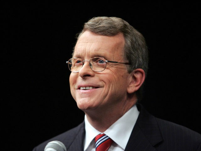 U.S. Sen. Mike DeWine (R - Ohio) smiles while looking at a T.V. camera before facing off October 19, 2006, against challenger U.S. Rep. Sherrod Brown (D - Ohio) before a live Televised debate at the Stranahan Theater in Toledo, Ohio. (Photo by J.D. Pooley/Getty Images)