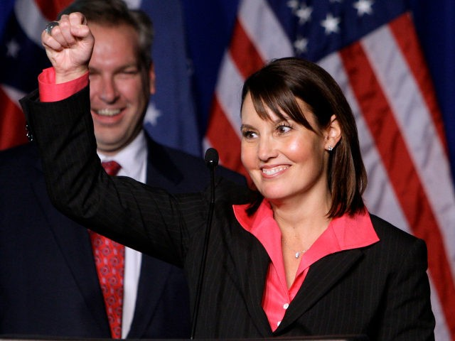 In this Nov. 3, 2010 file photo, then Ohio Republican Lt. Gov.-elect Mary Taylor celebrates at the Ohio Republican Party celebration, in Columbus, Ohio. Taylor, who is also Ohio's director of insurance, says she's experienced the same computer glitches that have frustrated many potential applicants searching for insurance plans under …
