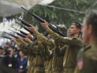 Israeli soldiers fire a gun salute during a Memorial Day ceremony to commemorate the country's fallen soldiers, at Mount Herzl military cemetery in Jerusalem, Wednesday, April 22, 2015. (Ammar Awad/Pool photo via AP)
