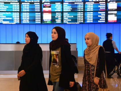 Travellers from the Middle East arrive at the International Arrivals section at Los Angeles International Airport on June 29, 2017, where free legal advice was offered and activists protested President Donald Trump's ban temporarily barring entry into the US from Libya, Iran, Somalia, Sudan, Syria and Yemen. The ban prevents …