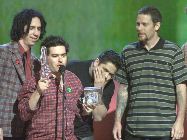 NOFX, skateboarding's music artist of the year, accidentally broke their award at the 'ESPN Action Sports and Music Awards' at the Universal Amphitheatre in Los Angeles, Ca. 4/7/01. Photo by Kevin Winter/Getty Images.