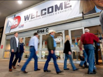 Attendees enter the National Rifle Association Annual Meeting on Friday, May 4, 2018, at the Kay Bailey Hutchison Convention Center in Dallas. (AP Photo/Jeffrey McWhorter)