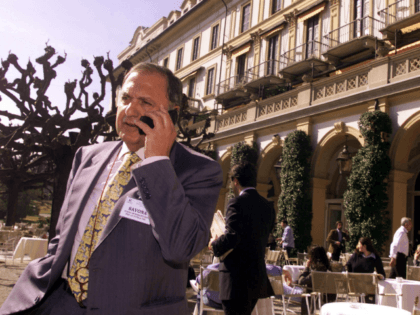 Paolo Savona talks on a phone at the Ambrosetti economic workshop on competition in the financial markets at Cernobbio, Lake Como, Italy, Friday, March 10, 2000. (AP Photo/Luca Bruno)