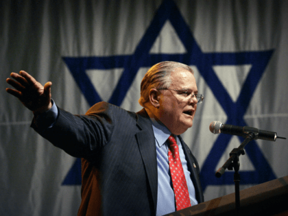 """In this April 6, 2008, file photo influential Texas evangelist John Hagee of Christians United for Israel addresses a crowd of his followers and Israeli supporters at a rally at the Jerusalem convention center. """"In my zeal to oppose anti-Semitism and bigotry in all its ugly forms, I have often …"""