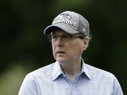 Seattle Seahawks owner Paul Allen watches an NFL football minicamp practice Wednesday, June 18, 2014, in Renton, Wash. (AP Photo/Elaine Thompson)