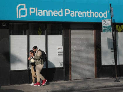 Pedestrians walk past a Planned Parenthood clinic on May 18, 2018 in Chicago, Illinois. The Trump administration is expected to announce a plan for massive funding cuts to Planned Parenthood and other taxpayer-backed abortion providers by reinstating a Reagan-era rule that prohibits federal funding from going to clinics that discuss …