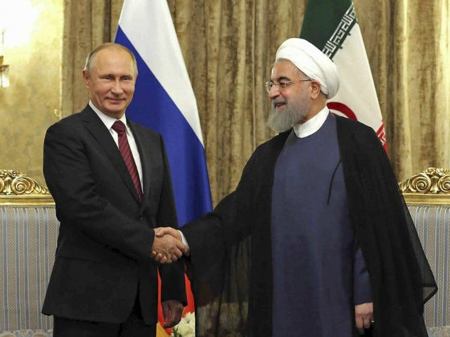 A handout picture provided by the office of the Iranian President Hassan Rouhani on November 1, 2017 shows him meeting with Russian President Vladimir Putin in Tehran.