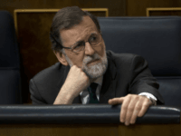 Spain's Prime Minister Mariano Rajoy and Popular Party leader listens to speeches during the first day of a motion of no confidence session at the Spanish parliament in Madrid, Thursday, May 31, 2018. The lower house of the Spanish parliament is debating whether to end Prime Minister Mariano Rajoy's close …