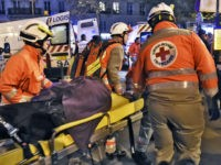 Rescue workers evacuate an injured person near the Bataclan concert hall in central Paris, on November 13, 2015. At least 39 people were killed in an 'unprecedented' series of bombings and shootings across Paris and at the Stade de France stadium on November 13. AFP PHOTO / DOMINIQUE FAGET (Photo …