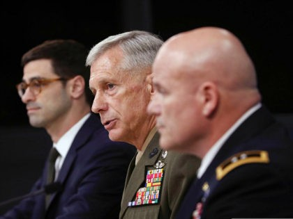 Marine Gen. Thomas D. Waldhauser, commander, U.S. Africa Command, center, with Assistant Secretary of Defense for International Security Affairs Robert S. Karem, left, and Army Maj. Gen. Roger L. Cloutier, right, chief of staff, U.S. Africa Command, and lead investigating officer, brief members of the media at the Pentagon, Thursday, …