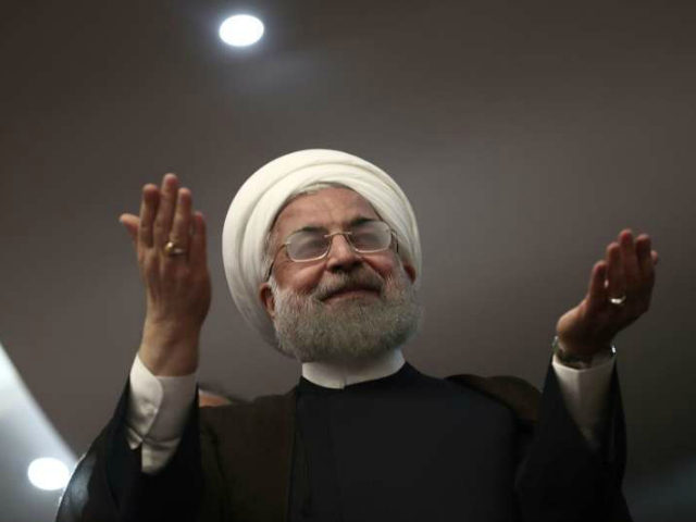 Iranian President Hassan Rouhani gestures during a campaign rally in the northwestern city of Ardabil on May 17, 2017