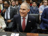Environmental Protection Agency Administrator Scott Pruitt takes his seat as he arrives to testify before the House Energy and Commerce subcommittee hearing on Capitol Hill in Washington, Thursday, April 26, 2018. Sitting next to Pruitt is Holly Greaves, EPA Chief Financial Officer. (AP Photo/Pablo Martinez Monsivais)