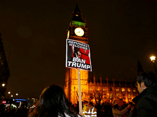 Demonstrators hold a banner during a protest against U.S President Donald Trump's controversial travel ban on refugees and people from seven mainly-Muslim countries, in London, Monday, Jan. 30, 2017. On Friday President Trump signed an executive order halting the US refugee programme for 120 days, indefinitely banning all Syrian refugees …