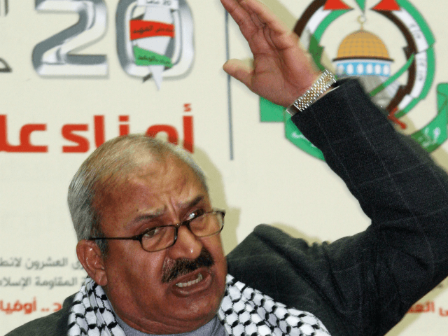Talal Naji, the assistant secretary-general of the Popular Front for the Liberation of Palestine –General Command , reads the statement of the Damascus-based radical Palestinian factions during a festival held Friday, Jan. 4, 2008 at al-Haifaa Sports Stadium in Damascus to mark the 20th anniversary of Hamas' foundation. Naji urged …