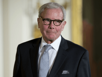 In this Nov. 24, 2014, file photo, journalist Tom Brokaw is introduced before being awarded the Presidential Medal of Freedom during a ceremony in the East Room of the White House in Washington. A woman who worked as a war correspondent for NBC News says Brokaw groped her, twice tried …